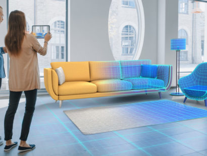 Schuster Innenausbau aus Salach – Decorating Apartment: Lovely Young Couple Use Digital Tablet with Augmented Reality Interior Design Software to Choose 3D Furniture for their Home. People Pick Sofa, Table and Lighting for Living Room